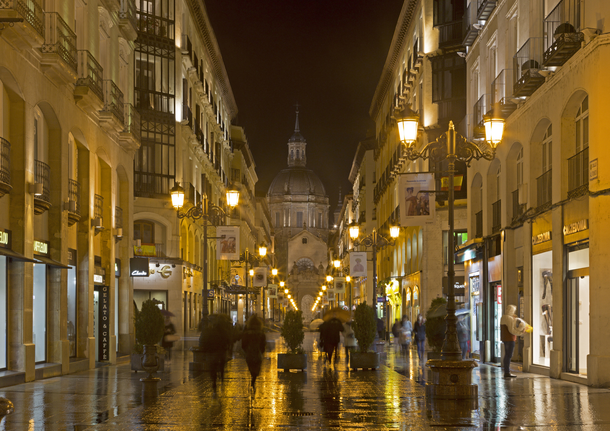 Zaragoza - The cathedral Basilica del Pilar and Calle de Alfonso I at rainly night.